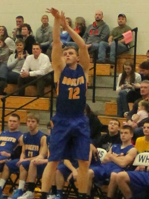 Clermont Northeastern's Brandon Mullins puts up a jumper during a 72-56 loss to Williamsburg Friday.
