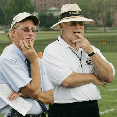 Purdue head coach Joe Tiller, right, and athletic director