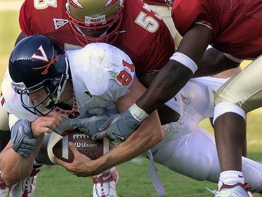 Virgina tight end Chris Luzar (81) is brought down