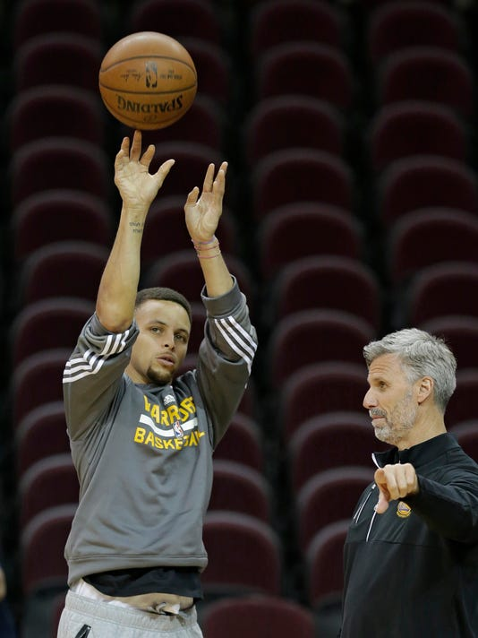 Golden State Warriors' Stephen Curry shoots during practice for Game 6 of the NBA basketball Finals, Wednesday, June 15, 2016, in Cleveland. The Cleveland Cavaliers will play the Warriors Thursday night in Cleveland. (AP Photo/Tony Dejak)