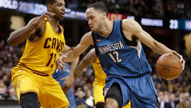 Minnesota Timberwolves' Tayshaun Prince (12) drives past Cleveland Cavaliers' Tristan Thompson (13), from Canada, in the second half of an NBA basketball game, Monday, Jan. 25, 2016, in Cleveland. The Cavaliers won 114-107.
