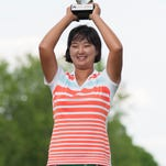 Min Seo Kwak holds up her trophy for winning the inaugural FireKeepers Casino Hotel Championship in Battle Creek last summer.
