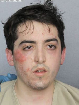 This photo provided by Broward County Sheriff's Office shows Alexander Sperber. A federal judge in Florida has ruled that Sperber, who robbed a bank, stripped naked and ran down the street throwing stolen money into the air is so severely mentally ill, he can't be held responsible for the crime. Chief U.S. District Judge K. Michael Moore found Sperber not guilty by reason of insanity following a 25-minute trial on Wednesday, Jan. 31, 2018. Sperber will remain jailed while receiving mental health treatment.