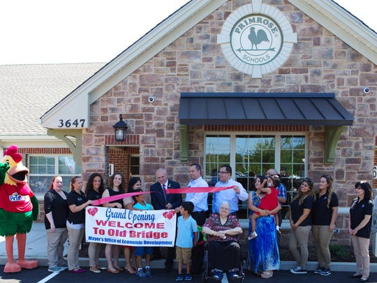 "On July 23, Old Bridge Mayor Owen Henry attended the ribbon-cutting ceremony for the grand opening of Primrose School of Old Bridge. He is pictured alongside franchise owners Abraham, David and Sulmeet Ezekiel and other Primrose teachers, staff and families.The Ezekiel family is excited to bring a new Primrose school to the Old Bridge, Manalapan and Marlboro communities. ""As passionate entrepreneurs and longtime residents of New Jersey, we are excited to offer Primrose Schools and the quality education and care environment it provides to local children and families,"" said Abraham Ezekiel. ""Our hope is that our school will provide parents — both living in the community and commuting to the city — with peace of mind knowing their children are growing their Active Minds, Healthy Bodies and Happy Hearts."" Primrose School of Old Bridge is at 3647 Route 9 North. Call 732-252-8694 or visit www.PrimroseOldBridge.com."