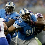 Detroit Lions Ndamukong Suh rushes against the Buffalo Bills Seantrlel Henderson during third quarter action at Ford Field in Detroit Sunday, October 5, 2014.