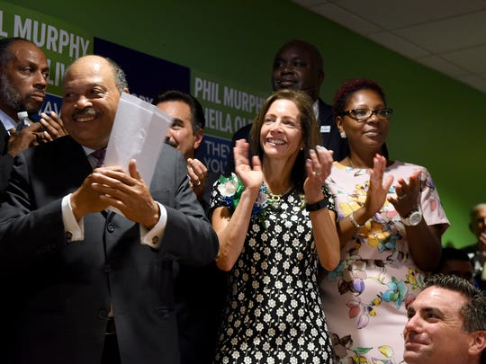 John Currie, second from left, chairman of the New Jersey Democratic State Committee, and Tammy Murphy, wife of Phil Murphy, next to Currie, cheer on Democratic gubernatorial nominee Murphy in July as he formally announces Sheila Oliveras his running mate.