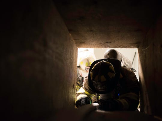 "SAFD's Rapid Intervention Team (RIT) enters a tunnel in a ""structure fire"" leading a firefighter that had gotten lost to safety during a training exercise July 26, 2017."
