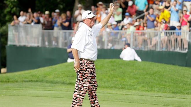 Mark Calcavecchia reacts after winning the Champions Tour's Principal Charity Classic golf tournament, Sunday, June 7, 2015, in Des Moines, Iowa. (AP Photo/Charlie Neibergall)