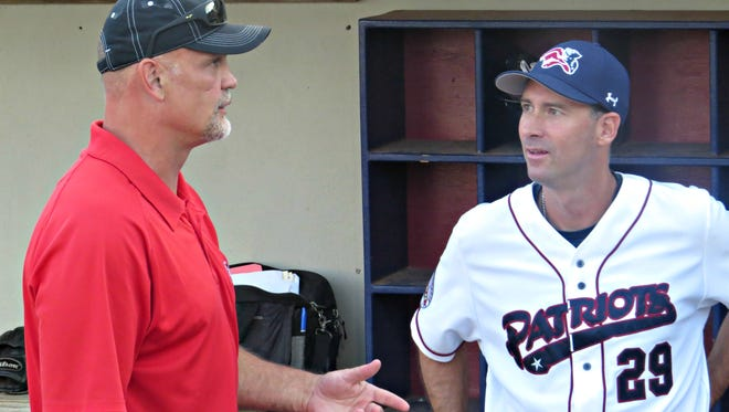 Ken Daneyko, a beloved and legendary defenseman for the New Jersey Devils, talks with Somerset Patriots manager  Brett Jodie before a game at TD Bank Ballpark in Bridgewater.