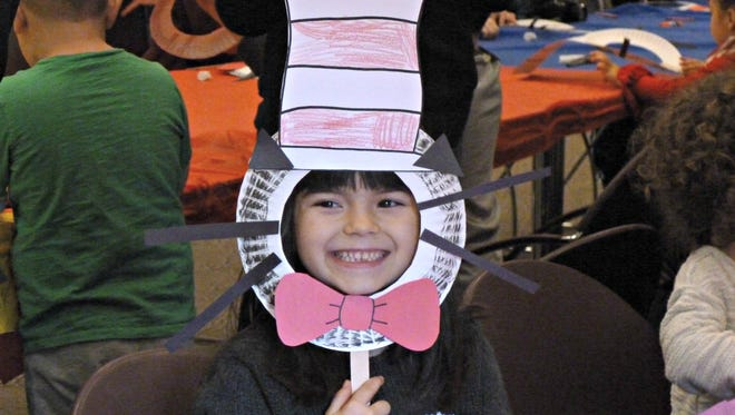 Gianna Gallo shows off the Cat in the Hat mask that she made during Franklin Township Library's celebration of Dr. Seuss' birthday on March 5.