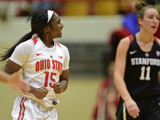 Ohio State's Linnae Harper, left, celebrates after making a shot during the third quarter of an NCAA college basketball game against Stanford, Friday, Nov. 10, 2017, in Columbus, Ohio. (AP Photo/David Dermer)