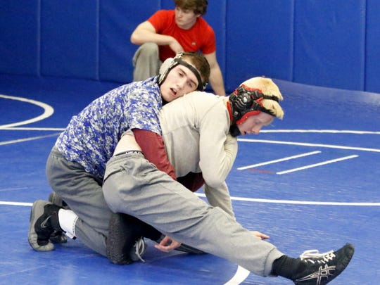 Wesley Woodworth, left, of Horseheads trains with Elmira's Noah Carpenter on Wednesday during a combined practice at Horseheads High School.