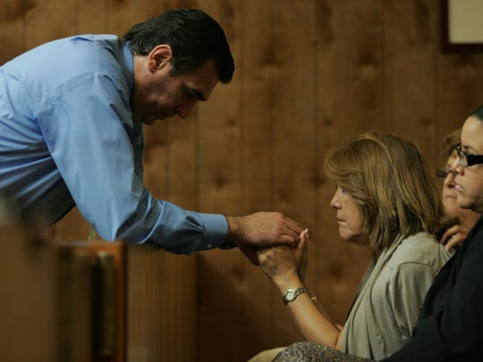 Manuel Avila holds hands with his wife, Carmen Avila, after being found not guilty in 2010.