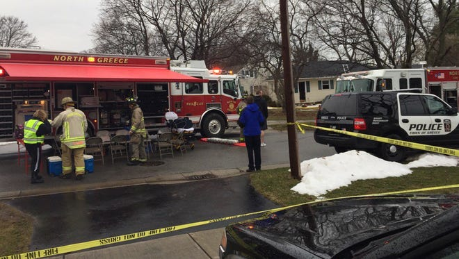 Firefighter received minor injuries after falling through a hole fighting a fire at an empty home in Greece.