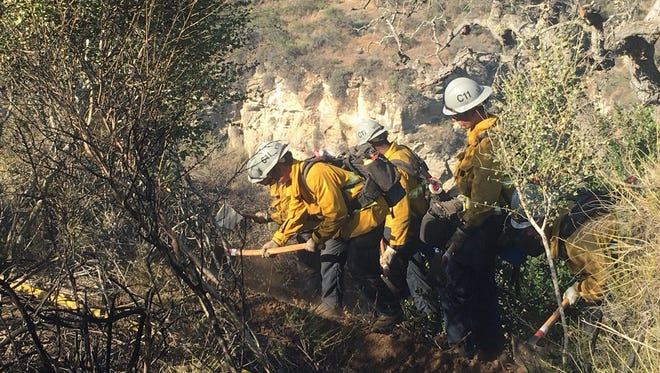 Firefighters battled a brush fire Monday afternoon in Thousand Oaks.