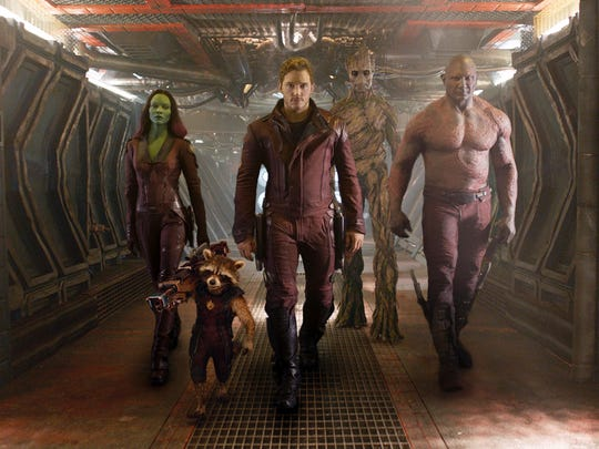 """Marvel shows Zoe Saldana, the character Rocket Racoon, voiced by Bladley Cooper; Chris Pratt, the character Groot; voiced by Vin Diesel; and Dave Bautista in a scene from """"Guardians Of The Galaxy."""""""