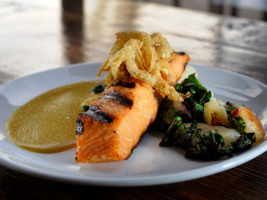 "Be sure to check out the ""simple fish dish"" of the day. On a given Saturday, it was pan-seared salmon on a puddle of coconut-lentil puree, sidled by brown butter Swiss chard-potato hash. What a delectable plate of food — creative, sophisticated, seasonal and a remarkable value at $13."