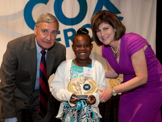 Inspirational Hero Cla'Jinnae Hamilton, a second grader at Charles M. Burke Elementary, is seen with Lafayette Parish Superintendent Donald Aguillard and Julie Dronet, Cox Acadiana market vice president.