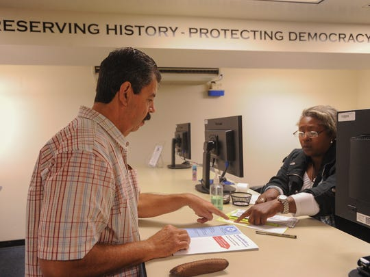 Art Jaramillo, of Oxnard, receives his ballot from