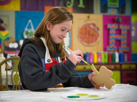 Juliana Greaney, 10, of Evansville, works on a painting at SnickerDoodle Art, Saturday, March 4, 2017. SnickerDoodle Art held their grand reopening party for their new location on Franklin Street, Saturday.