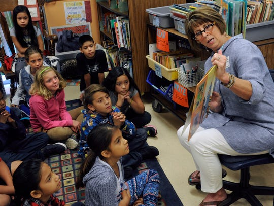 Fourth-graders at Jackson Elementary School listen