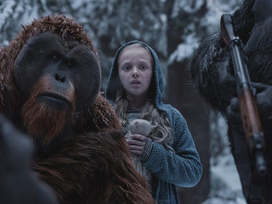 "Maurice (left, played by Karin Konoval via performance capture) protects new charge Nova (Amiah Miller) in ""War for the Planet of the Apes,"" in theaters July 14."