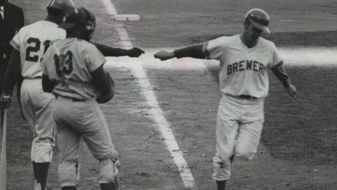 """Brewers pitcher Skip Lockwood, a converted infielder, hits a home home run in the first game he pitched with the Brewers against the Washington Senators at County Stadium on May 19, 1970. Tommy Harper awaited Lockwood at the plate with Senators catcher John Roseboro. Lockwood, who played four of his 13 big-league seasons with the Brewers, recounts his career in his new book """"Insight Pitch."""""""