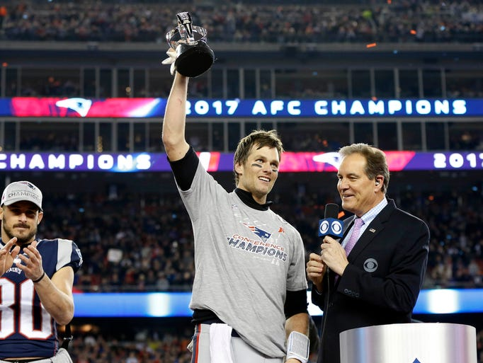 Tom Brady holds up the Lamar Hunt Trophy after the