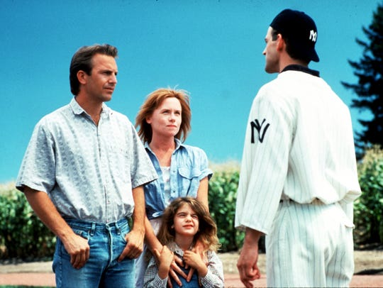 "Kevin Costner, far left, stars in ""Field of Dreams,"""