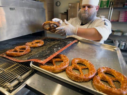 Evan Speelman makes soft pretzels at York City Pretzel