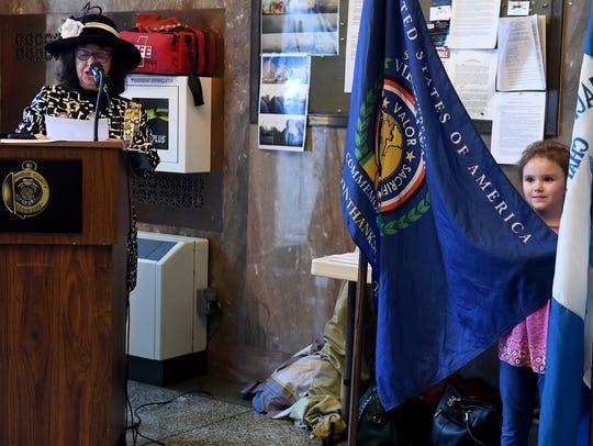Alyvia Baxter holds up the Vietnam Veterans Commemorative