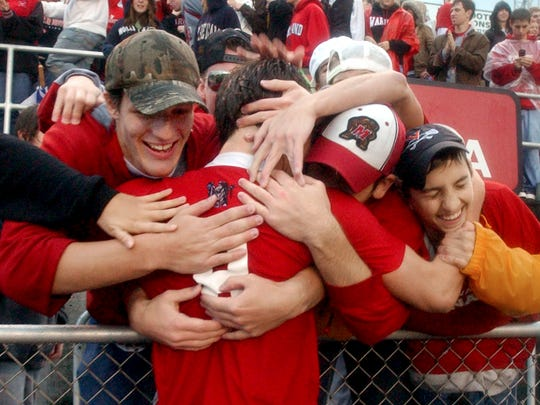 Sam Wendler, who scored the only goal in Susquehannock's 1-0 state championship soccer win in 2008, is mobbed by fans after the game.