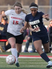 Kimberly High School's Reilly Lamirande (15) battles for the ball against Appleton North High School's Izzie Ruzzicone (11) during their girls soccer game on Monday, April 23, 2018 in Kimberly, Wis.