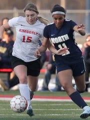 Kimberly High School's Reilly Lamirande (15) battles
