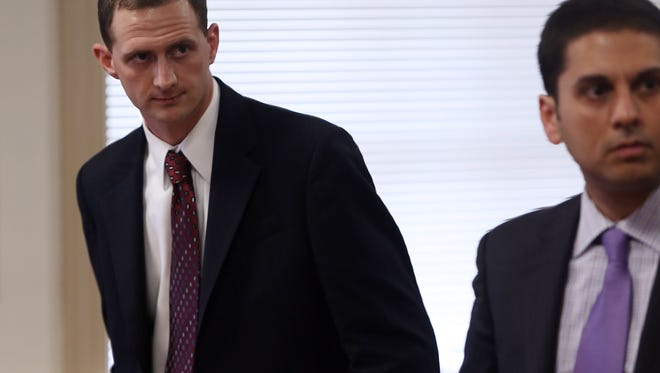 Former Mount Olive Officer Ryan Eastridge, l, and his attorney, Lee Vartan, arguing in Morris County Superior Court that Eastridge should be allowed to withdraw his guilty plea, given in 2014, to obstruction of justice.   February 23, 2017, Morristown, NJ.