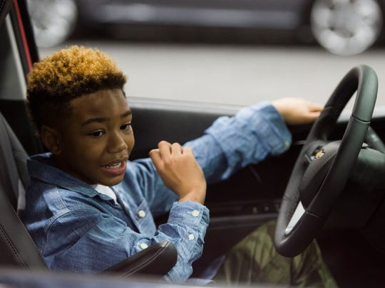 Greg Duff, 8, of Knoxville checks out a car last year at the Knox News Auto Show.