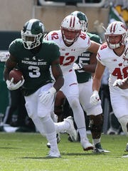 Michigan State Spartans RB LJ Scott runs the ball against the Wisconsin Badgers on Saturday, Sept. 24, 2016 at Spartan Stadium.