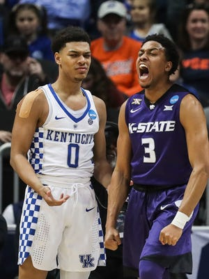 Kentucky's Quade Green reacts as Kansas State's Kamau Stokes cheers after hitting the two point and drawing the foul in Thursday night's Sweet Sixteen game in Atlanta, March 22, 2018.