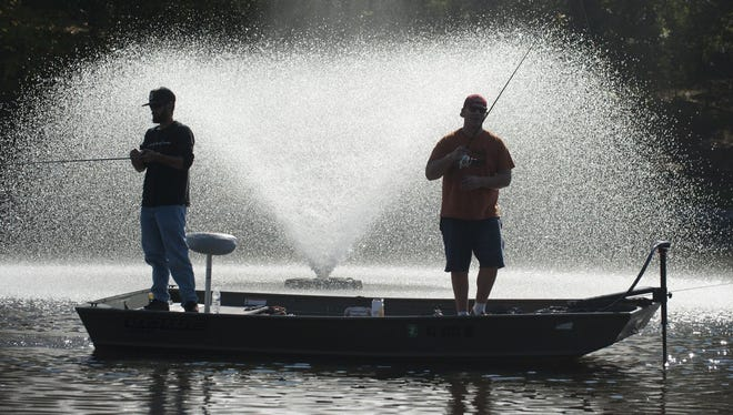 Kenny Iverson (left) of Bellmawr and Angelo Dilorenzo of Mt. Ephraim go fishing on Newton Lake in Haddon Twp.