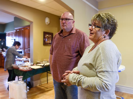 Annette and Brett Larsen talk about how they organize a traditional Christmas dinner each year at the Gorecki Guest House Monday, Dec. 25, in St. Cloud.