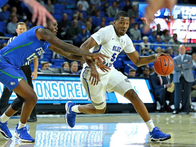 MTSU forward Nick King drives to the basket in a game