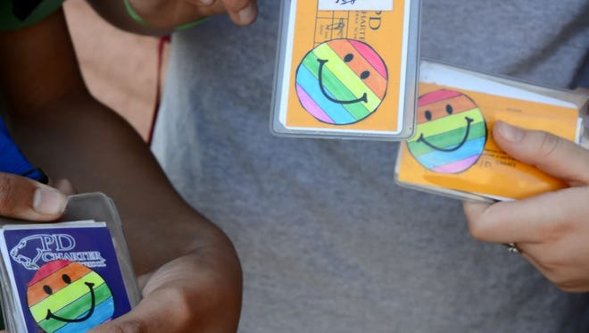 Students wear rainbow smiley faces on their ID badges to show support for the LGBTQ community.