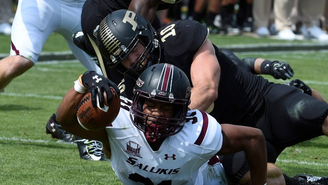 Southern Illinois Salukis running back Malcolm Agnew (31) tackles Purdue Boilermakers linebacker Sean Robinson (10) as he reaches for the end zone in the second half at Ross Ade Stadium.