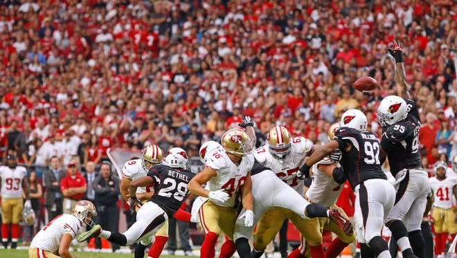 Cardinals defensive end Tommy Kelly (95) blocks a field goal by San Francisco 49ers kicker Phil Dawson (9) in the 4th quarter of  their NFL game Sunday, Sept. 21,  2014 in Glendale. The Cardinals won 23-14.