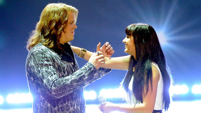 "Winner Caleb Johnson and runner-up Jena Irene react onstage during Fox's ""American Idol"" XIII Finale at Nokia Theatre L.A. Live on May 21, 2014, in Los Angeles."