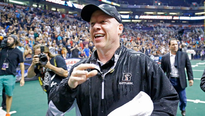 Arizona Rattlers head coach Kevin Guy reacts after being doused following their 72-56 win over the San Jose SaberCats in their National Conference final game on Aug. 10, 2014.