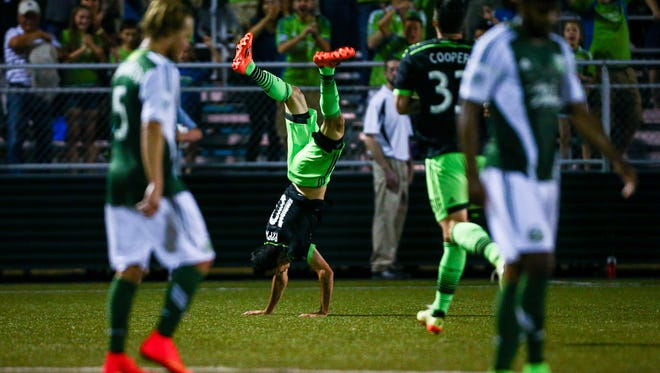 Seattle Sounders' Marco Pappa (10) flips after scoring a goal in extra time during an MLS soccer match against the Portland Timbers on Wednesday, July 9, 2014, in Tukwila, Wash. (AP Photo/seattlepi.com, Joshua Bessex) NO SALES; MAGAZINES OUT; SEATTLE TIMES OUT; TV OUT; MANDATORY CREDIT; TV OUT