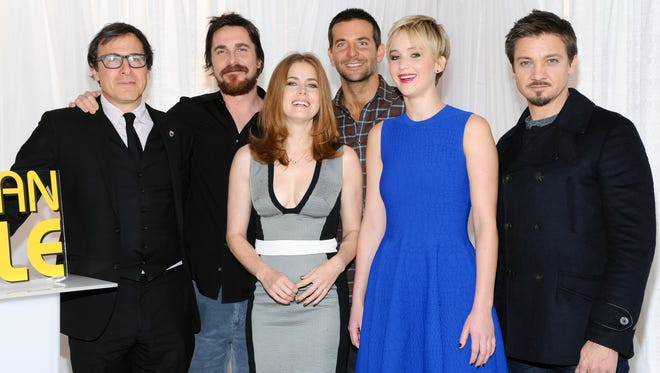 Director David O. Russell, left, poses with the cast of 'American Hustle' (Christian Bale, Amy Adams, Bradley Cooper, Jennifer Lawrence and Jeremy Renner) on Dec. 8, 2013, in New York City.