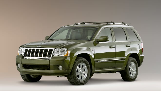 Chrsyler is probing whether millions of its most-popular models, such as this 2008 Jeep Grand Cherokee, have a potentially dangerous electrical flaw.  2008 Jeep(R) Grand Cherokee Limited - 3/4 Front View. JP008_007GC