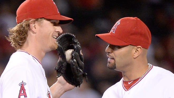 Jered Weaver and Albert Pujols of the Angels celebrate a 2-1 win over the  Astros at Angel Stadium of Anaheim.